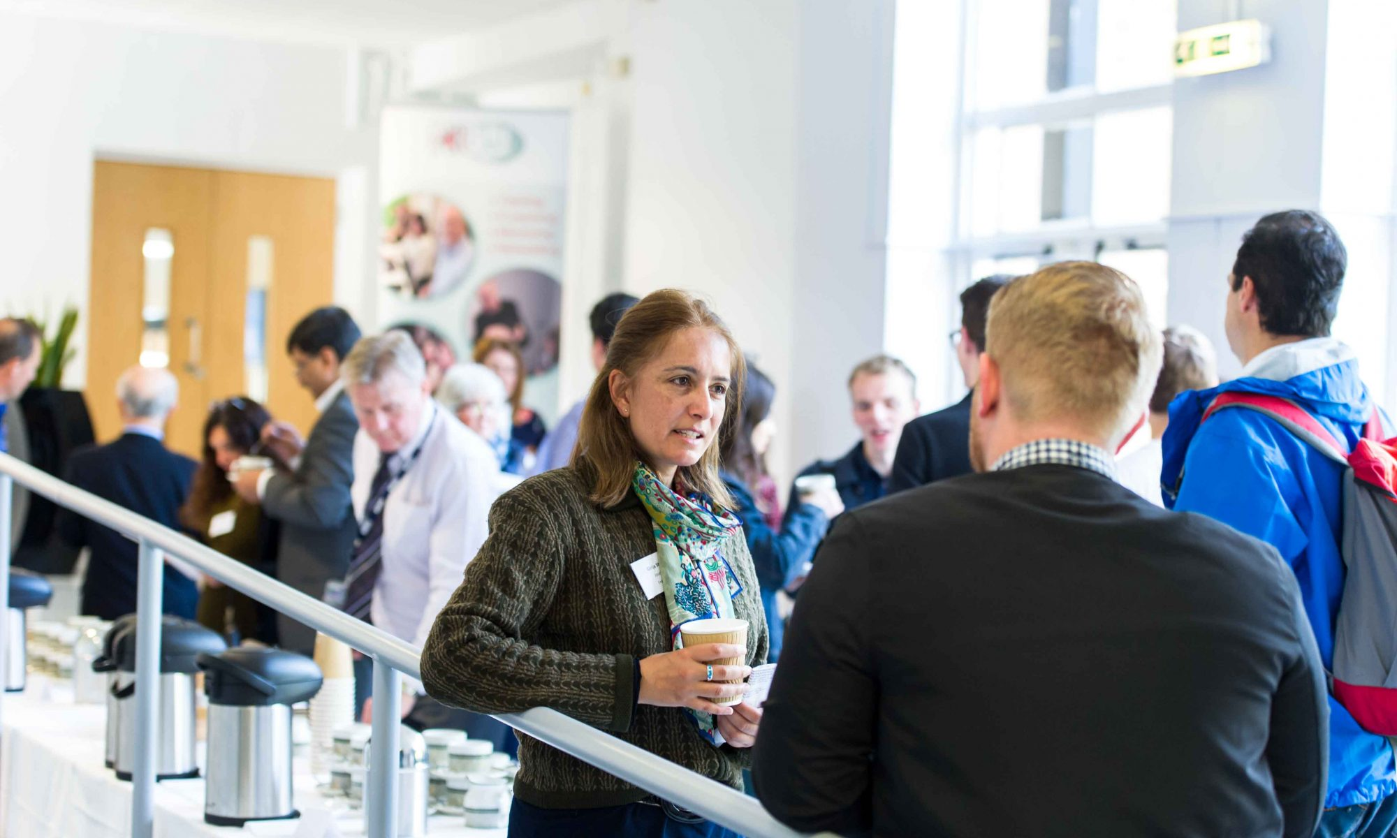 People networking in a large reception area