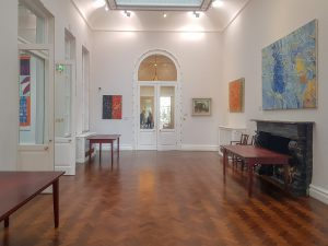 A view of the gallery on the first floor, where refreshments and lunch is served. This shows the entrance to the music room which is a quiet room during conference and also provides access to a lift. This is also next to entrance to the Wolfson room.