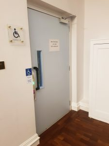 A view of the accessible lift that is suitable for those using power wheelchairs. It goes from the registration area to the entrance of the Wolfson Room (main conference room)